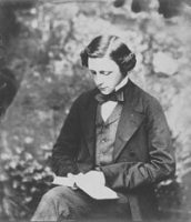 Lewis Carrow sitting and reading a book